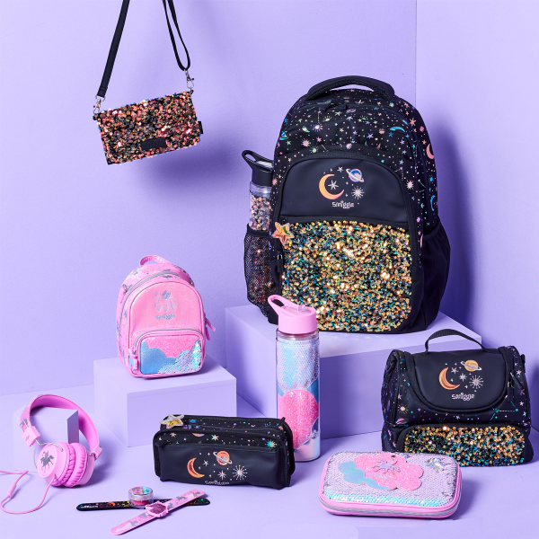 Bags and accessories on coloured background
